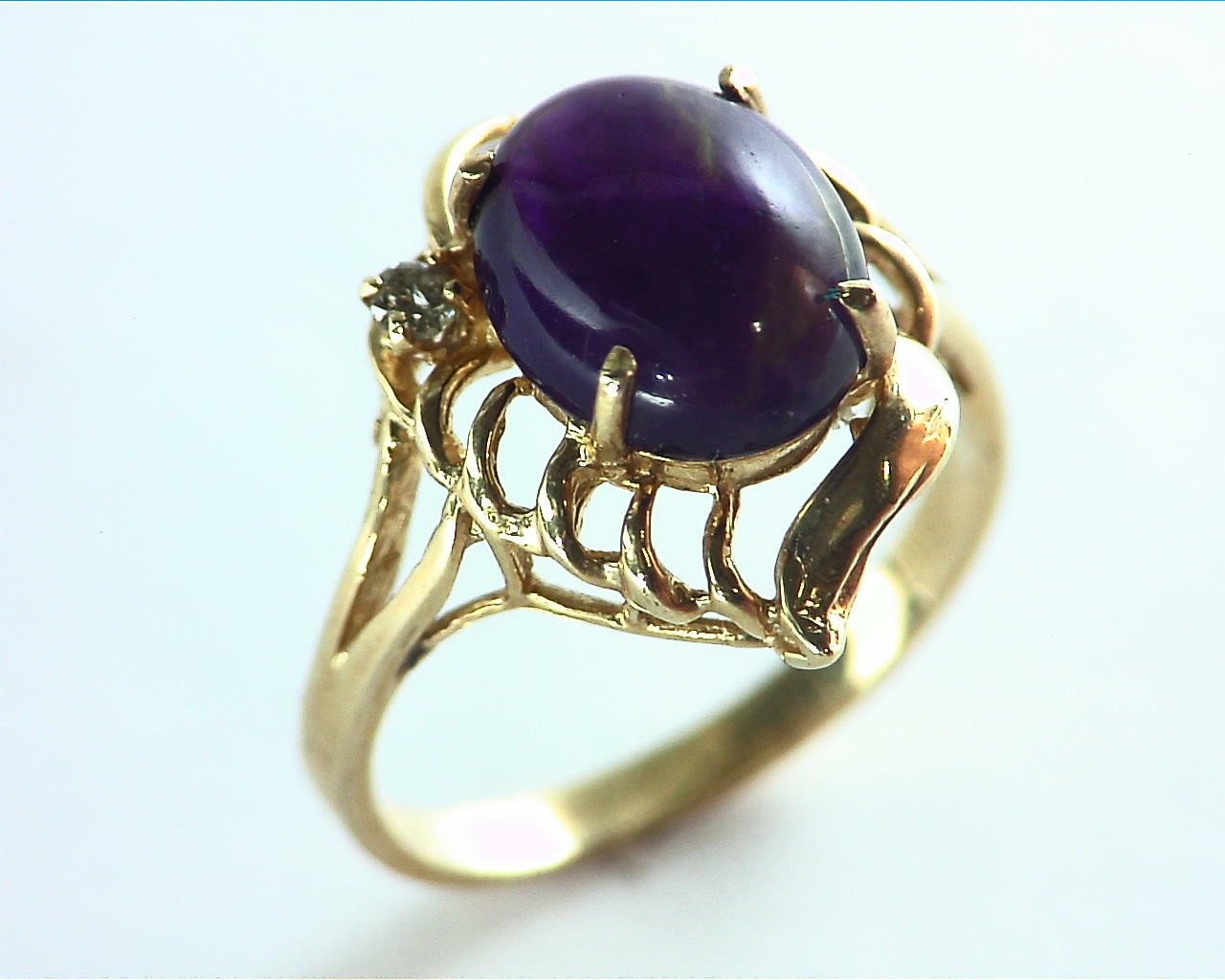 Amethyst set in a Beautiful 14 kt Yellow Gold Engagement Ring Design