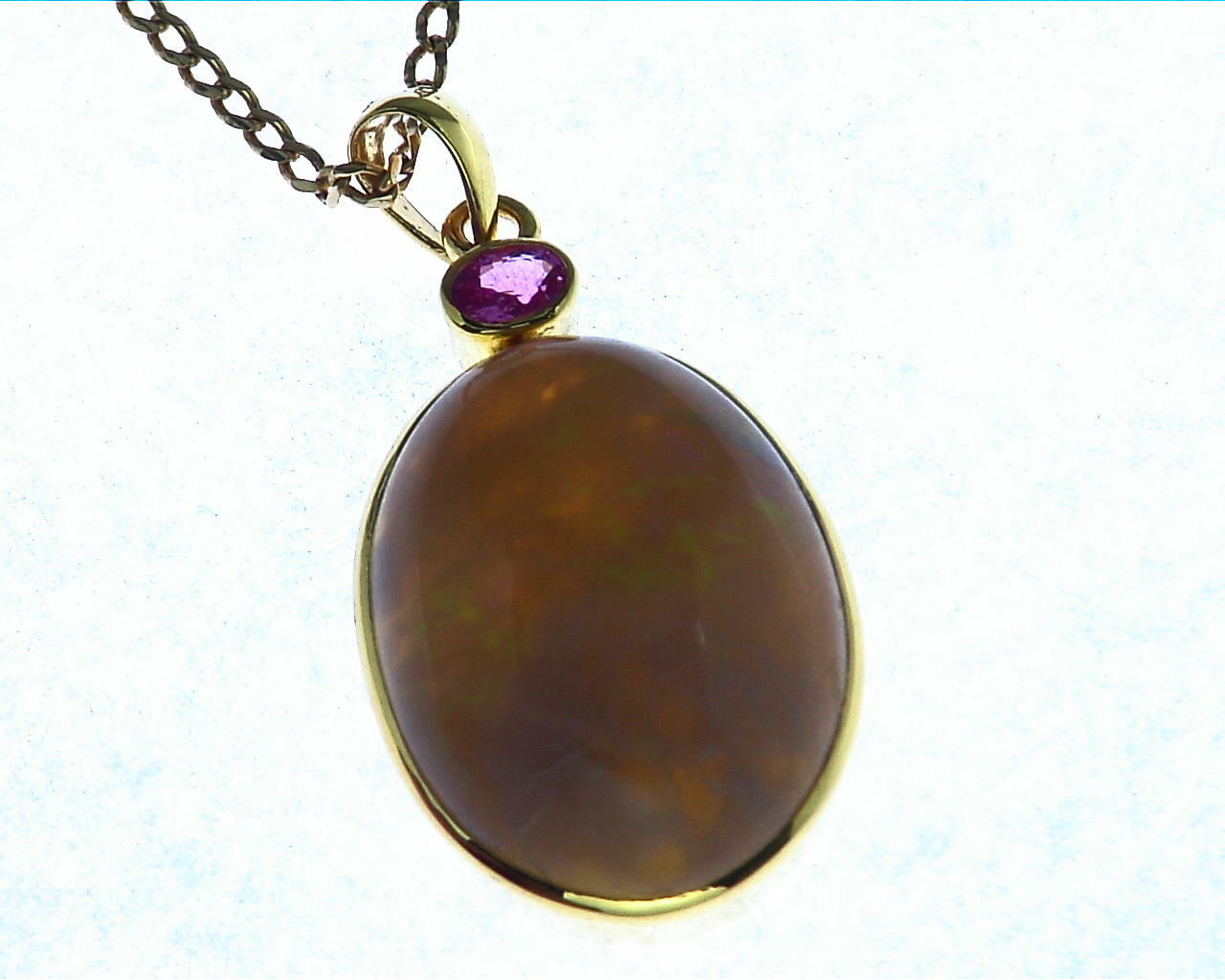 Opal (Australian) Natural Genuine Gemstone Set In 14 kt Yellow Gold With A Genuine Pink Sapphire Pendent